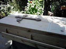 Pine casket with budded cross - viewing lid on